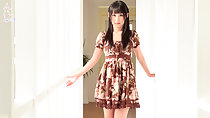 Standing in hall wearing brown dress long hair