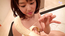 Mao playing with peeled banana