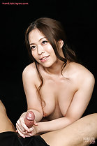 Breasts pressed between her arms giving handjob
