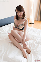 Kisaki Aya Sitting On Bed Wearing Bra Knees Drawn Up Bare Feet