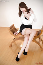 Kisaki Aya seated with legs crossed wearing stockings high heels showing cleavage in bra