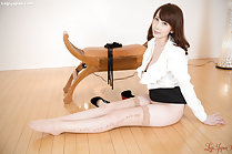 Office lady sitting on floor shirt open skirt raised long legs in stockings