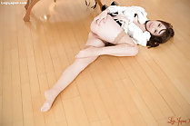 Kisaki Aya lying on her side leg drawn up wearing stockings