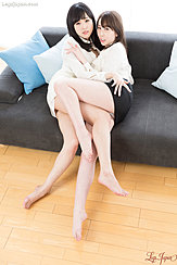 Girls Entwined On Sofa Wearing Short Skirts Bare Feet