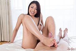 Rubbing Hard Cock Between Her Bare Feet