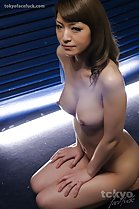 Kneeling nude big breasts hands on thighs