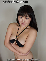 Arms Folded Under Her Chest Wearing Micro Bikini