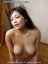 Saho kneeling naked face covered in bukkake cum running down over her big breasts