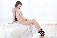 Sitting Naked On Bed Long Hair Big Breasts Hint Of Pussy Hair High Heels
