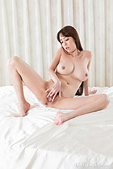 Seated On Bed Naked Big Breasts Spreading Her Pussy Bare Feet