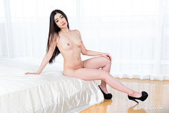 Sitting On Edge Of Bed Naked Long Hair Hand On Knee Wearing High Heels